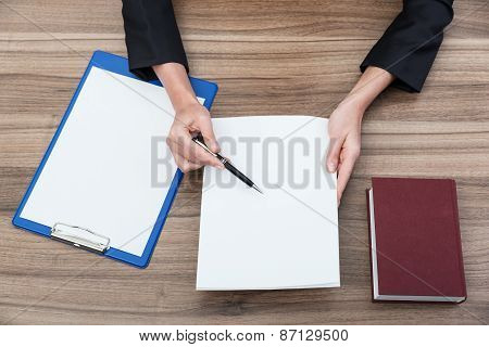 Closeup Of A Businesswoman's Hands While Checking Some Documents