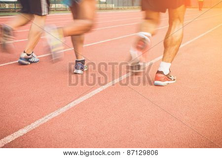 Running Track With Blur Of Runner Feet In Stadium