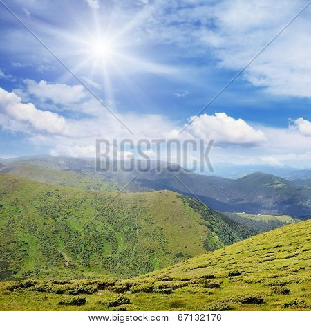 High mountains and sun on blue sky