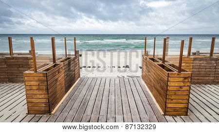 Wooden floor leads to the sea