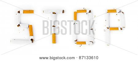 Word Stop made of broken cigarettes isolated on white background
