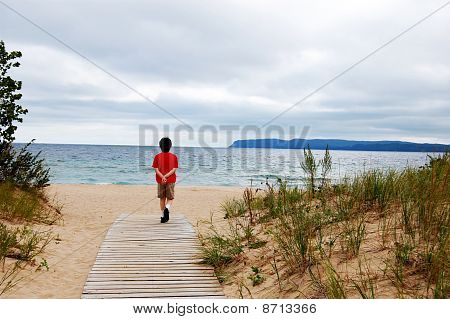 Boy Walking To Beach