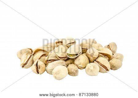 Group of pistachios closeup isolated on white
