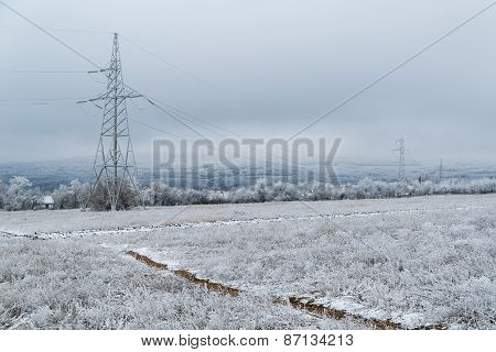 Electric Pole On The Background Of A Winter Landscape