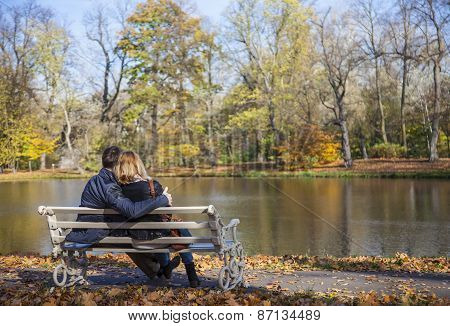 Cuddling couple on the bench