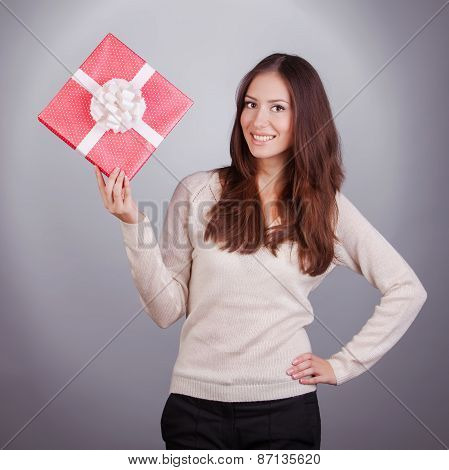 Portrait Of Beauty Young Woman With Christmas Gift On Gray Background