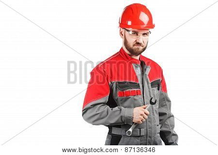 Man Wearing Overalls With Red Helmet And Wrench