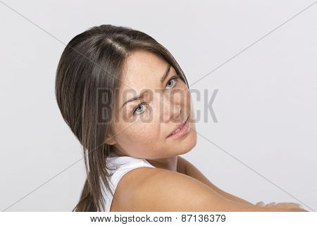 Young, nice woman with freckled skin and piercing in nose