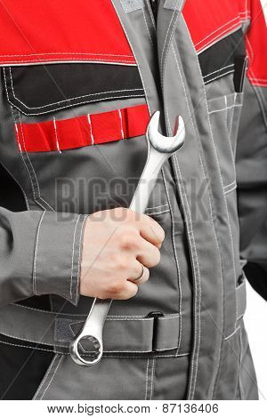 Hand Of Worker With Wrench