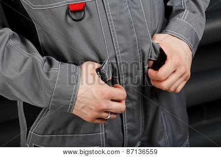 Hands Of Worker Wearing Overalls
