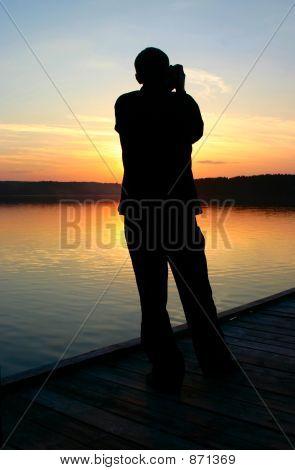 photographer capturing sunset 2