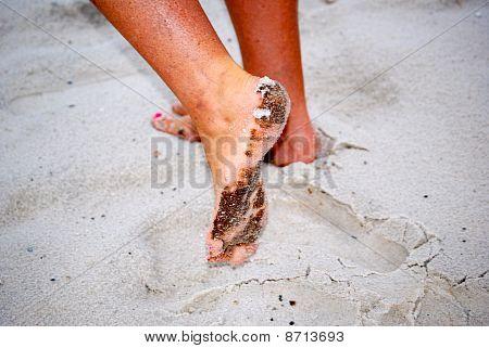 Oil residue from beach on feet