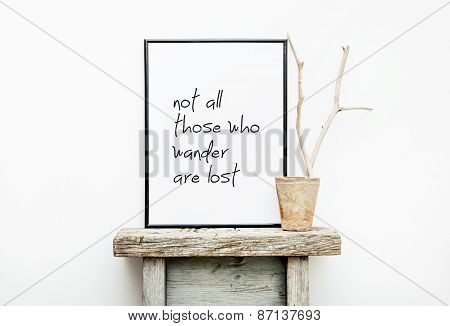 Motivational Frame Not All Who Wander Are Lost. Hipster Scandinavian Style Room Interior
