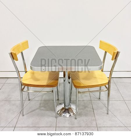 Table With Two Chairs In A Cafeteria