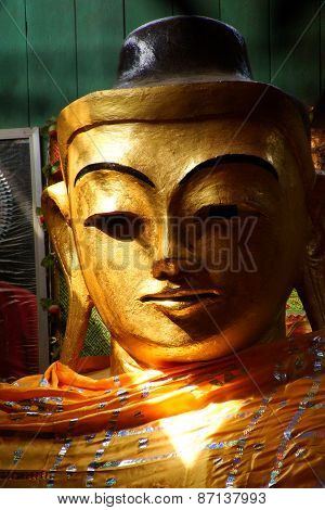 Golden Head Of Buddha