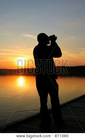 photographer capturing sunset