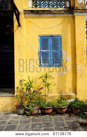 Blue Window On Yellow Wall