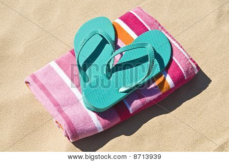 Flip-flops And Towel At The Beach.