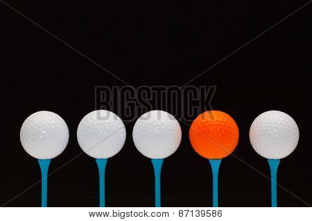 Golf Balls On Blue Wooden Tees