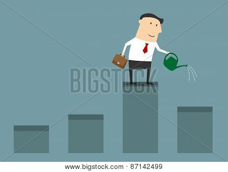Businessman watering graph for financial growth