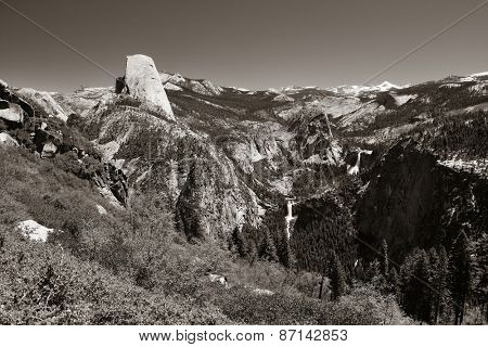 Yosemite mountain ridge with waterfall in black and white.