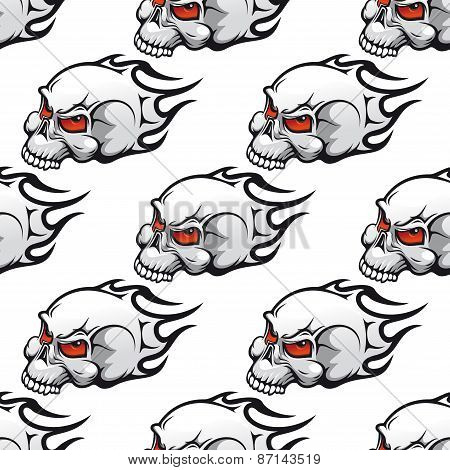 Cartoon skulls with tribal flames seamless pattern