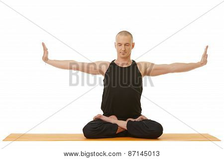 Image of concentrated man doing yoga exercise