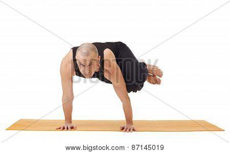 Yoga instructor looking at camera while exercising