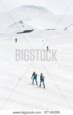 Ski mountaineers climb the Avacha Volcano on skis. Team Race ski mountaineering on Kamchatka