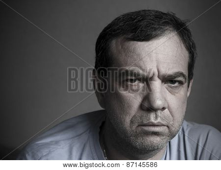 Gloomy sad man. Toned photo