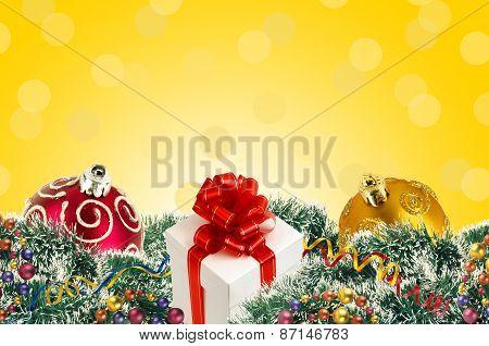 Gift Box And Christmas Tree Ornaments And Christmas Tree Branches And Christmas Balls Over Yellow Ba