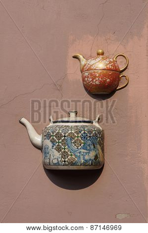 Ancient teapots embedded in facade of old building in Vilnius, Lithuania.