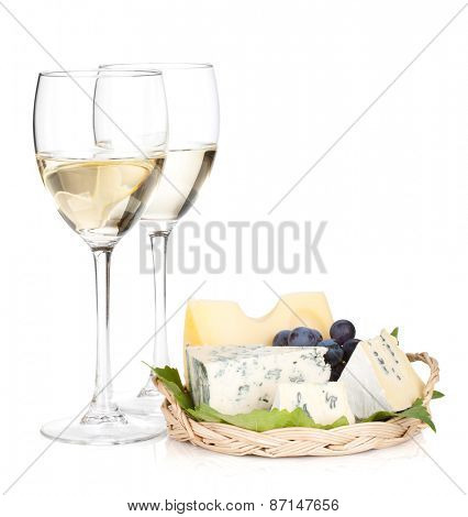 Cheese, grape and two white wine glasses. Isolated on white background