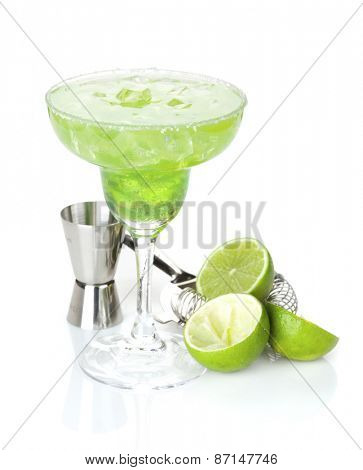 Classic margarita cocktail with salty rim with limes and drink utensils. Isolated on white background