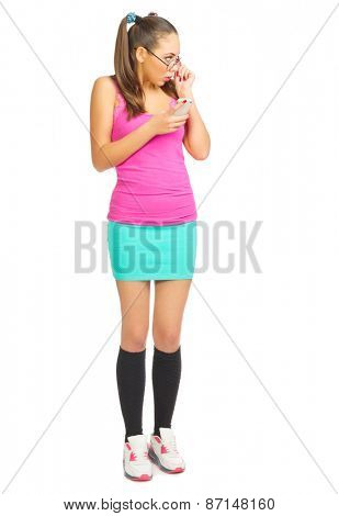 Schoolgirl with mobile phone isolated