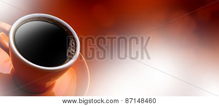 Cup of black coffee on bokeh background. Banner of a cup of coffee