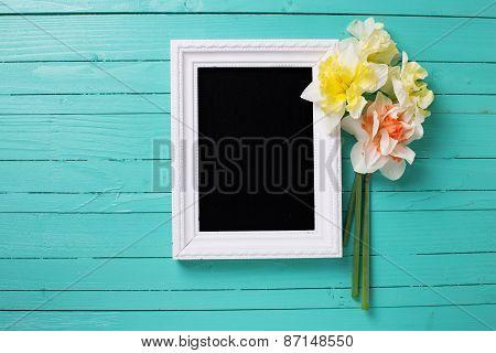 Background With Fresh Daffodils And Blackboard