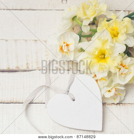 Background With Fresh Daffodils And Heart