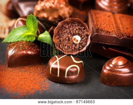 Chocolates. Chocolate. Assortment of fine chocolate praline in dark and milk chocolate with vanilla and mint. Variety of Chocolate sweets