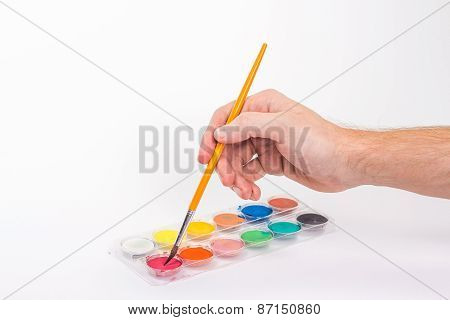isolated man's hand holding a brush artist