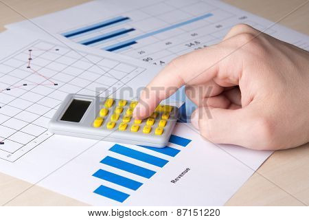 Business Concept - Graphs And Charts Analyzed By Accountant