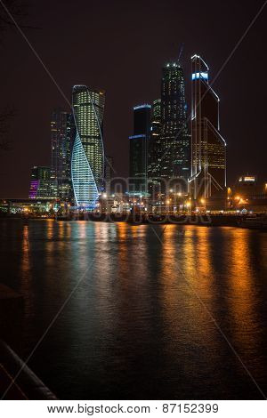 Picturesque Night View Of The Moscow City Across The River Moscow With Reflection In Water,
