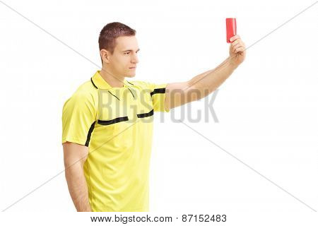 Young football referee in yellow dress showing a red card isolated on white background