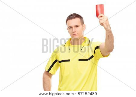 Strict football referee standing and showing a red card isolated on white background