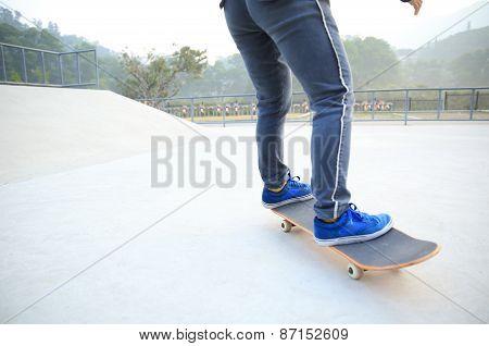 skateboarding legs at skate park