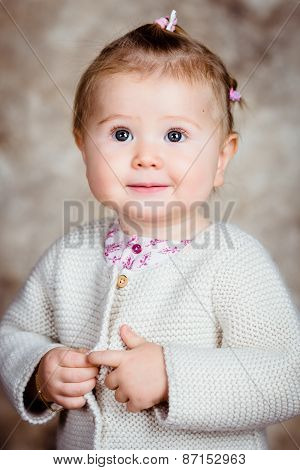 Close-up Portrait Of Beautiful Blond Little Girl With Big Grey Eyes And Plump Cheeks