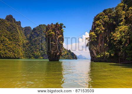 The tourist season in Thailand. Calm and warm Andaman Sea and the quaint island. James Bond Island