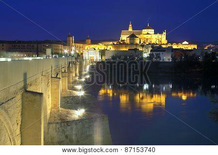 Cathedral Mezquita and Roman bridge at night, Guadalquivir river, Cordoba, Andalusia, Spain