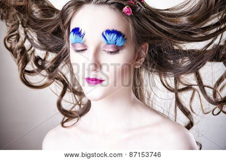 Beautiful Girl With Creative Make-up And Hairstyle