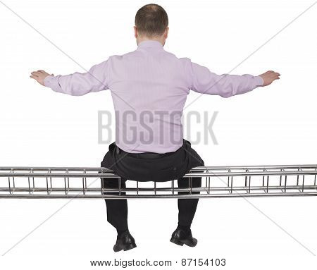 Businessman sitting on light metal girder beam on white background